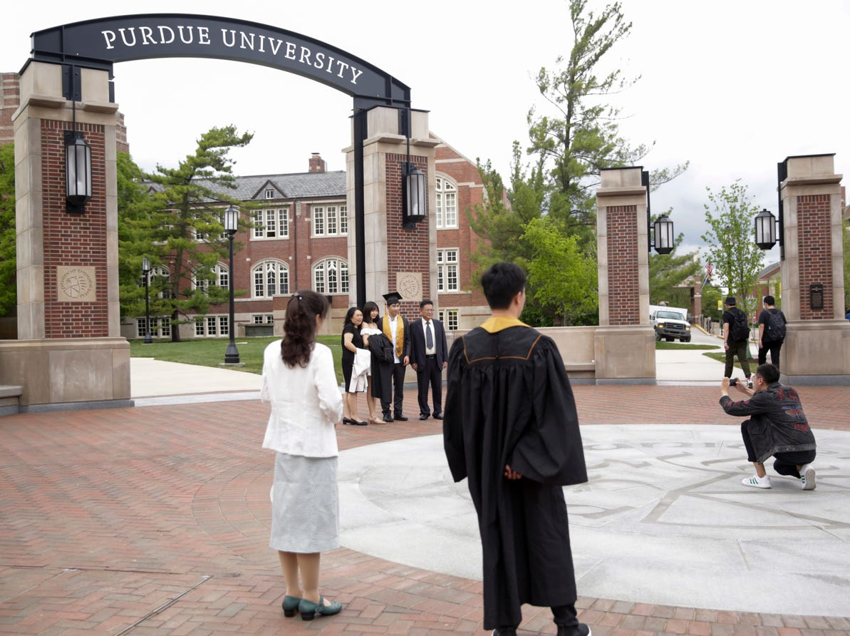 Students pose for photos in front of the new gateway at State and Grant streets, Thursday, May 9, 2019, at Purdue University in West Lafayette. Purdue finished its new $1.9 million gateway in time for this weekend's commencement ceremonies. The gateway was built to mark the university's 150th year.