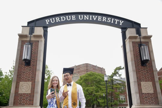 Samantha Tinney and Josh Xu pose for a selfie in front of the new gateway at State and Grant streets, Thursday, May 9, 2019, at Purdue University in West Lafayette. Purdue finished its new $1.9 million gateway in time for this weekend's commencement ceremonies. The gateway was built to mark the university's 150th year.