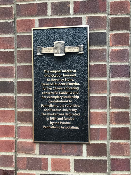 Purdue's new gateway at the corner of State and Grant streets includes a plaque remembering the original marker at the spot, which honored Beverley Stone, a former dean of students.