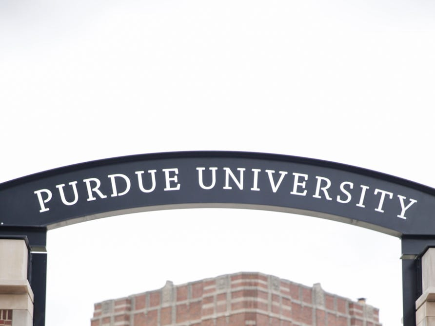 Emily Jackson poses for photos in front of the new gateway at State and Grant streets, Thursday, May 9, 2019, at Purdue University in West Lafayette. Purdue finished its new $1.9 million gateway in time for this weekend's commencement ceremonies. The gateway was built to mark the university's 150th year.