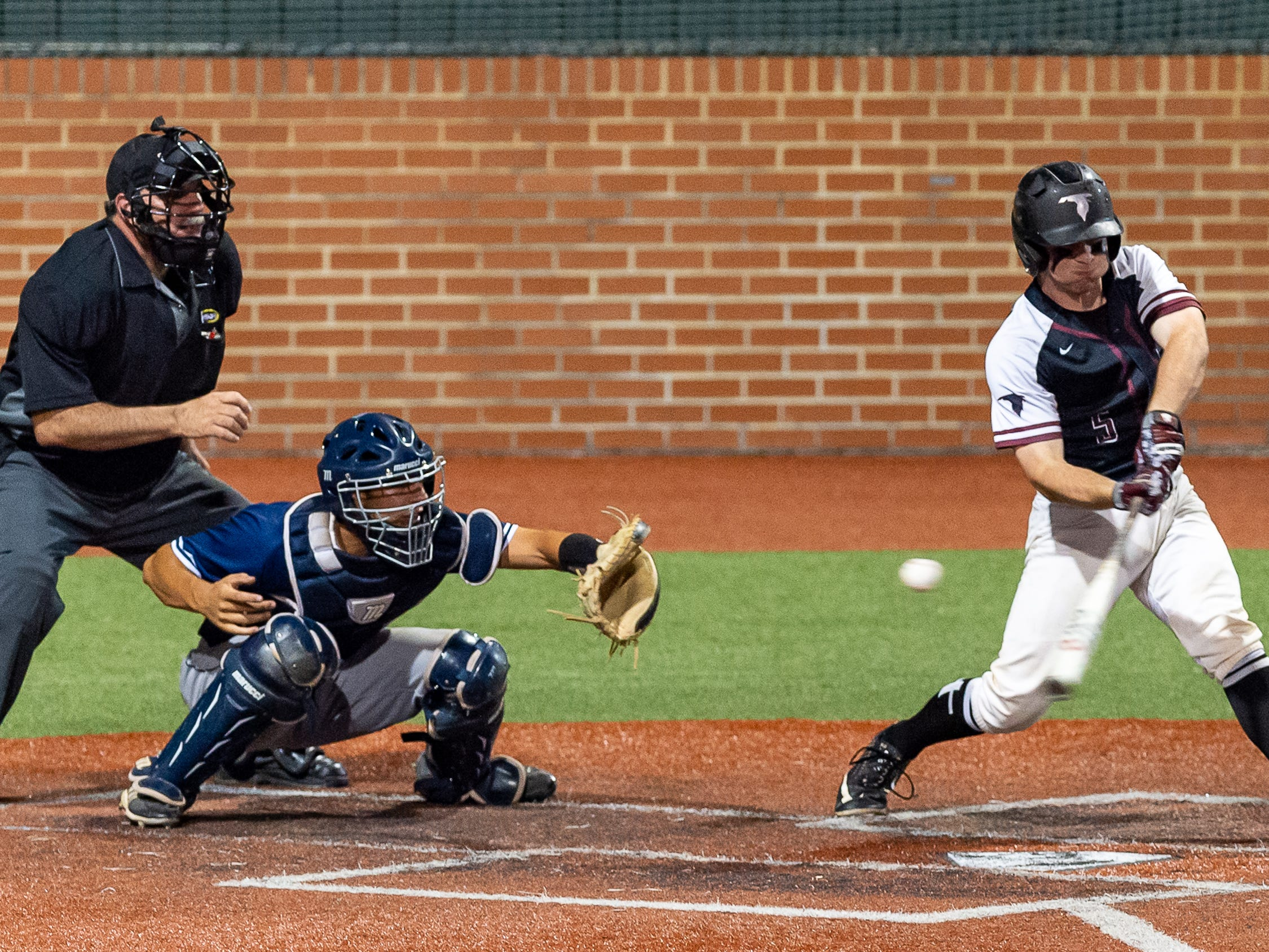 Austin Arceneaux working behind the plate as Ascension Episcopal takes on St. Thomas Aquinas in the semi final round at the LHSAA State Championship. Wednesday, May 8, 2019.