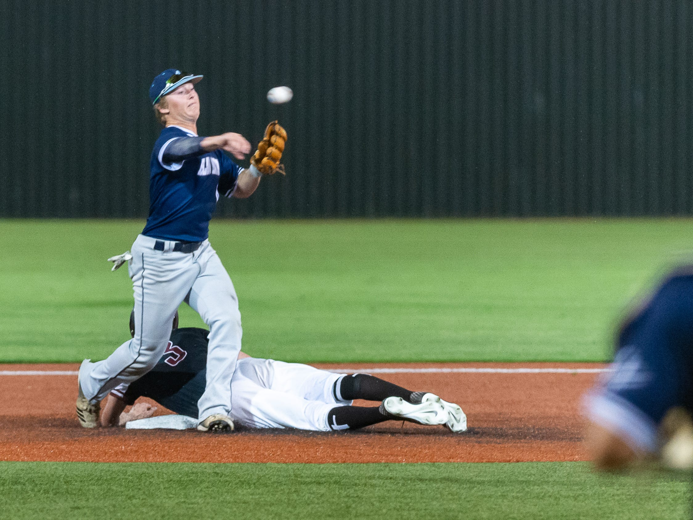 Seth Kerstetter turns the double play as Ascension Episcopal takes on St. Thomas Aquinas in the semi final round at the LHSAA State Championship. Wednesday, May 8, 2019.