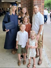Chelsie Theriot's family celebrate her at graduation Thursday. After 16 years being out of school, Theriot received her high school equivalency diploma with other graduates of South Louisiana Community College's WorkReadyU. With her are fiance Dustin Warren and children Kali, Lexa, Madden and E'leey.