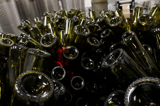 Empty bottles dry on racks waiting to be filled with wine Wednesday afternoon, May 8, 2019, at Herrenhaus Elflein Vineyard and Winery.