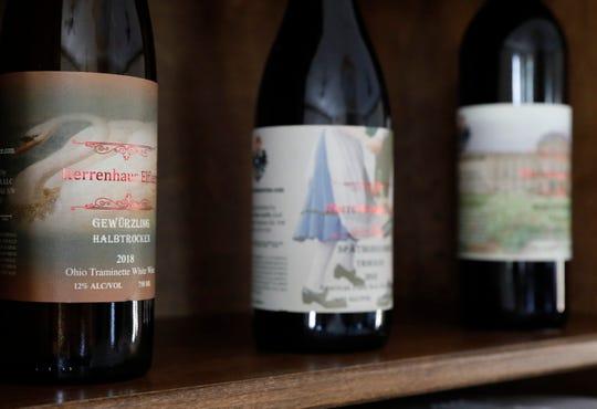 Bottles of Herrenhaus Elflein wine sit on a shelf in the winery's tasting room.