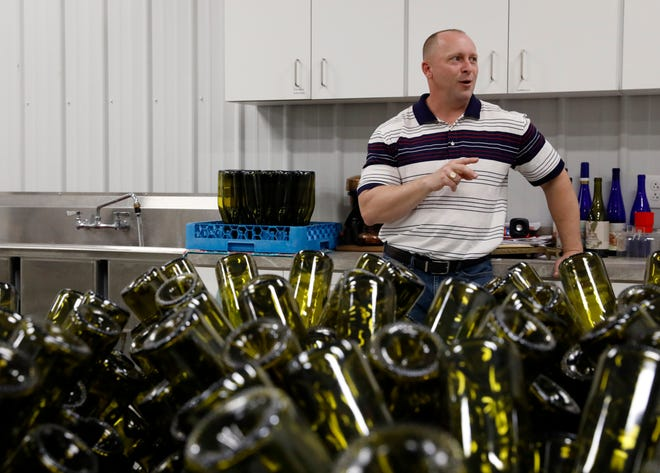Keith Elflein talks amongst empty bottles at Herrenhaus Elflein vineyard and winery Wednesday afternoon, May 8, 2019, in Bloom Township. Elflein plans to open the winery's tasting room in late May.