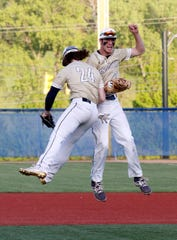 Lancaster's Casey Finck and Wes Ward celebrate after clinching the Ohio Capital Conference-Ohio Division last season, marking the second consecutive year the Golden Gales won the conference championship.