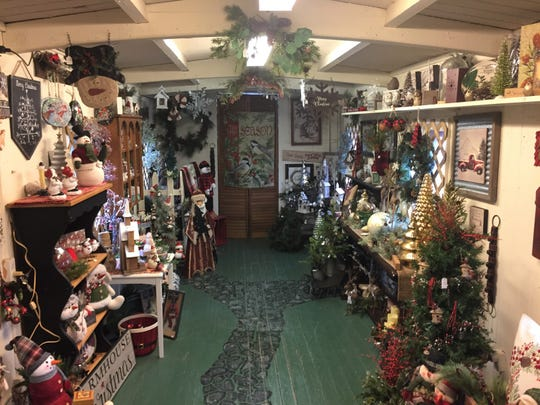 A 1901 caboose is filled with Christmas items for sale at Brighton store Wood 'N Things, Thursday, May 9, 2019. The shop is one of several locations to be featured in a Christmas movie being filmed in town.