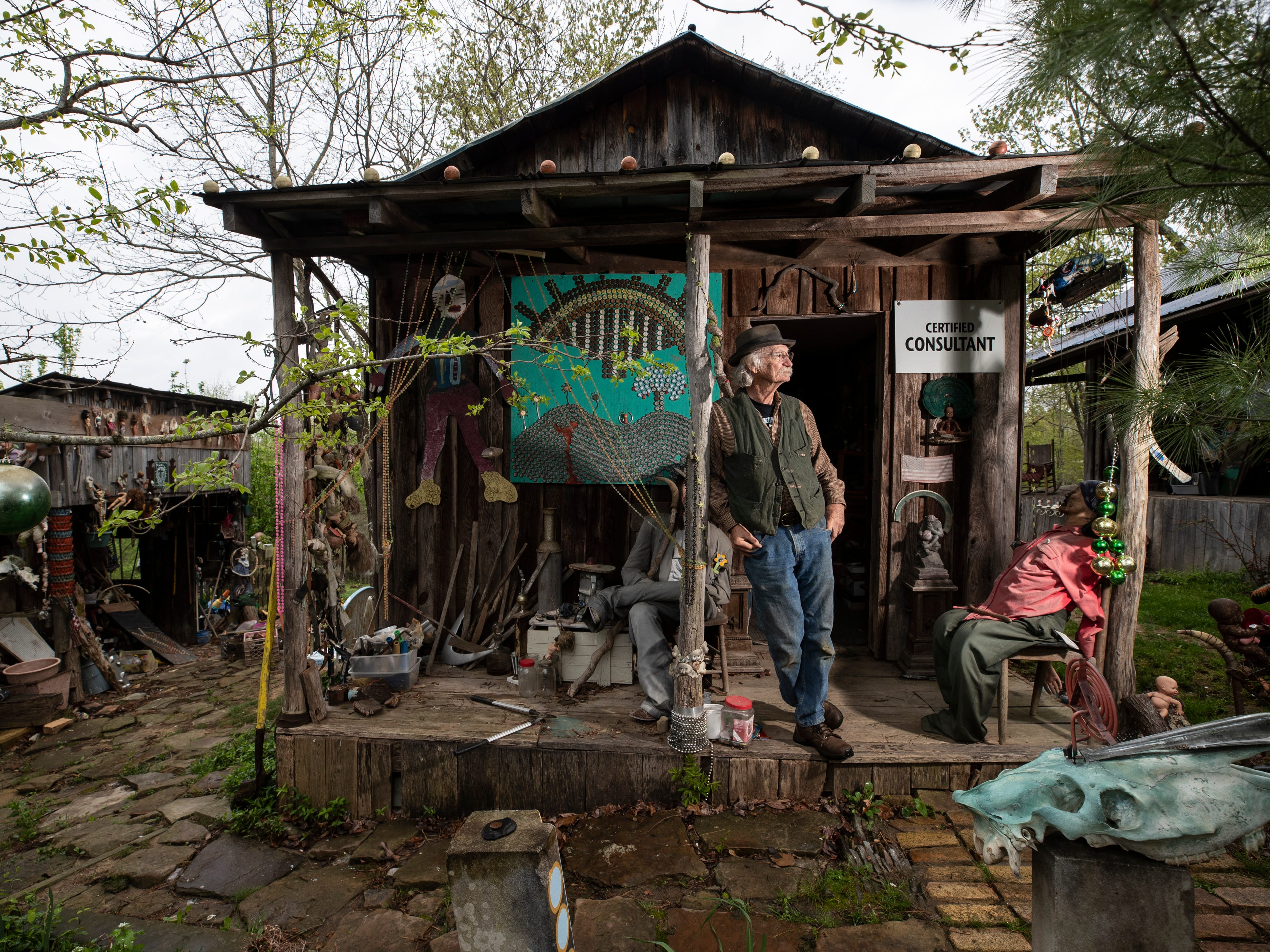 Cecil R. Ison stands on the porch of the Curation Facility #1 at the Home for Wayward Babydolls. April 19, 2019