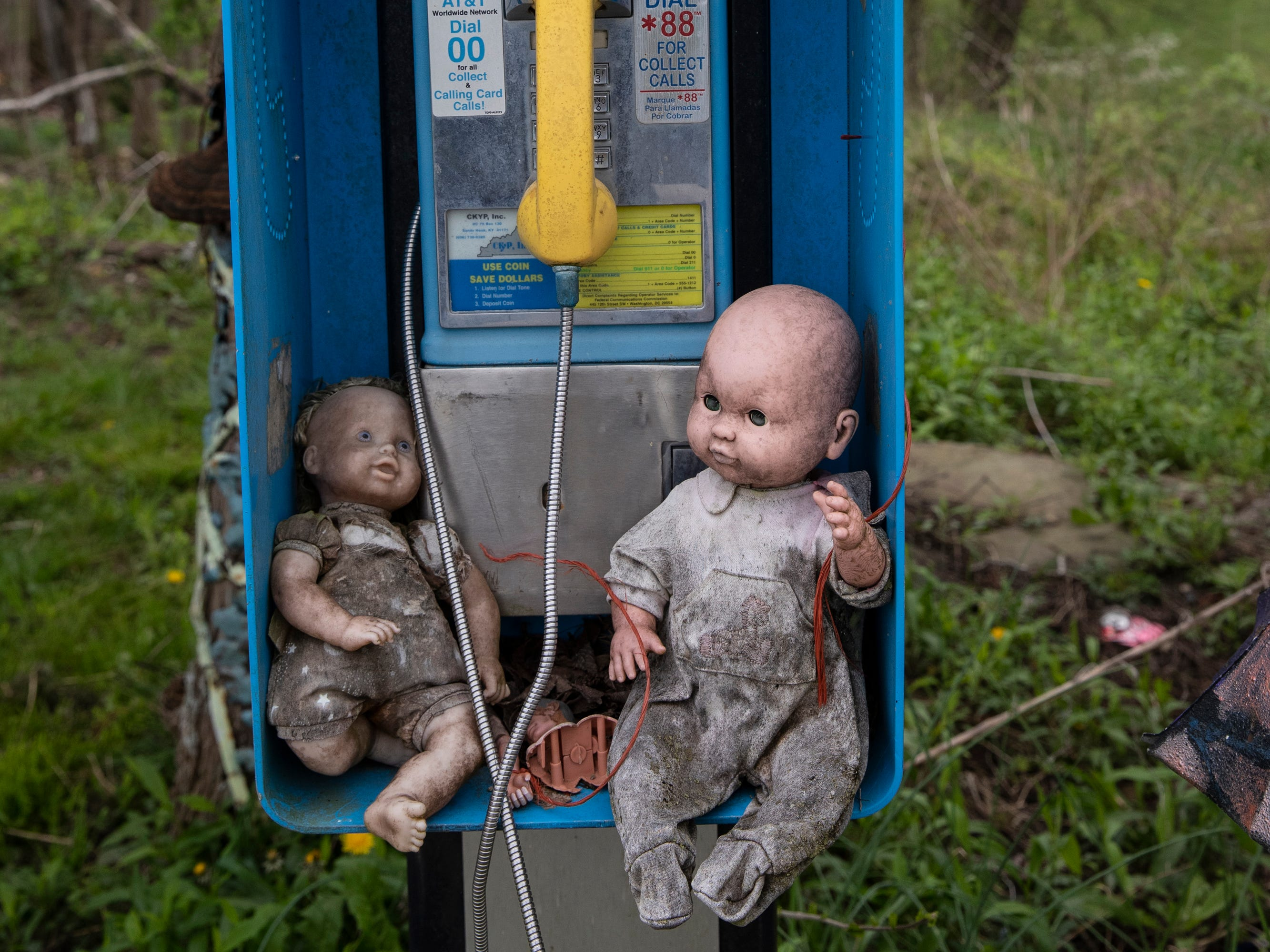 Two dolls inhabit a pay phone at the Home for Wayward Babydolls. April 19, 2019