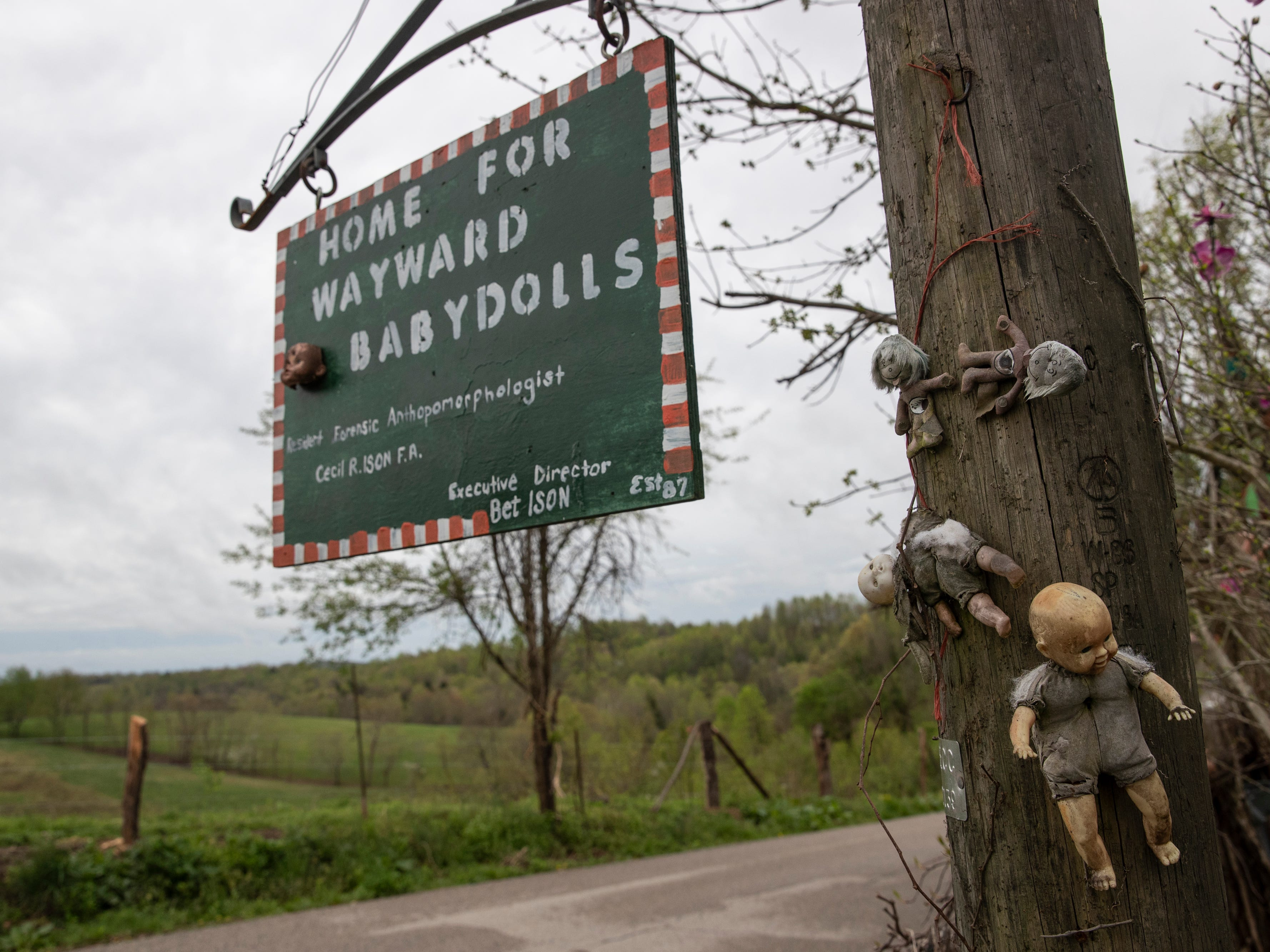 The Home for Wayward Babydolls sign hangs outside the home of Cecil and Bet Ison. April 19, 2019