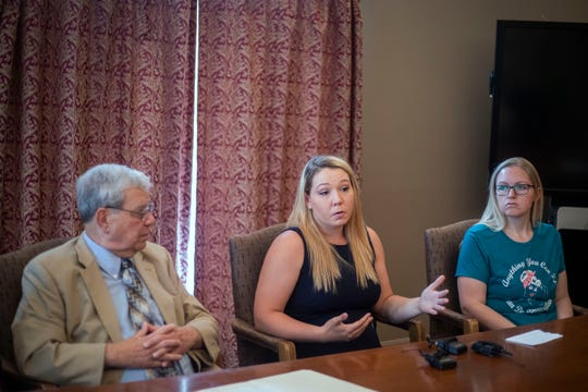 Myranda Juarez, center, speaks during a press conference at the Louisville Bar Association in downtown Louisville on Thursday, May 9, 2019.