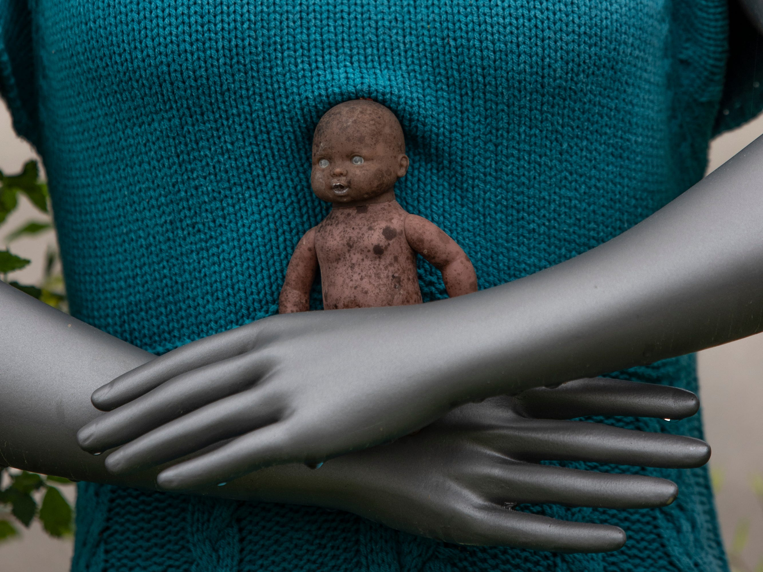 A small baby doll rests in the hands of a mannequin at the Home for Wayward Babydolls. April 19, 2019