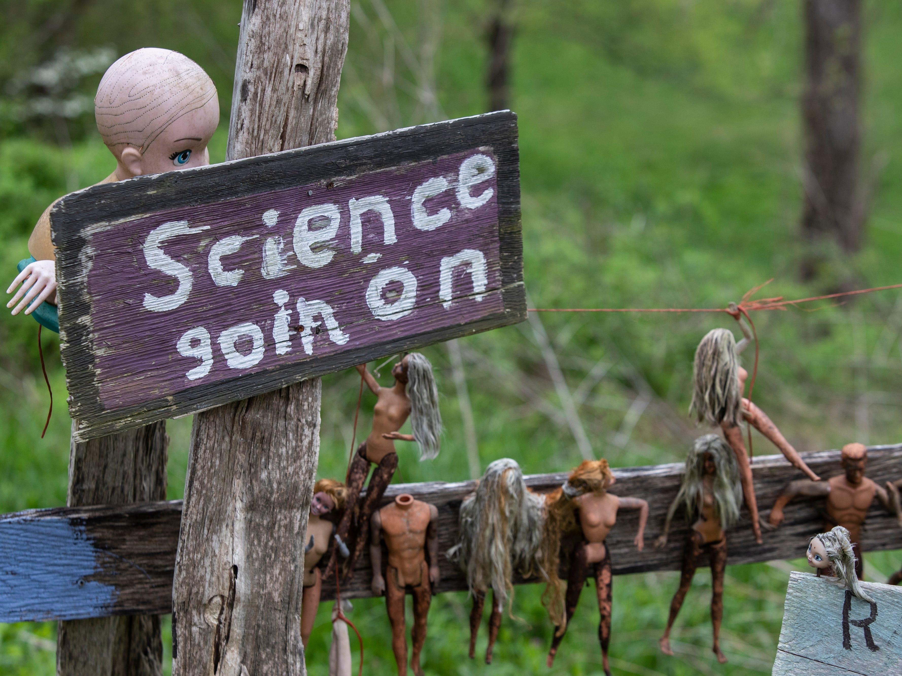 A sign indicating the scientific research is in progress at the Home for Wayward Babydolls. April 19, 2019