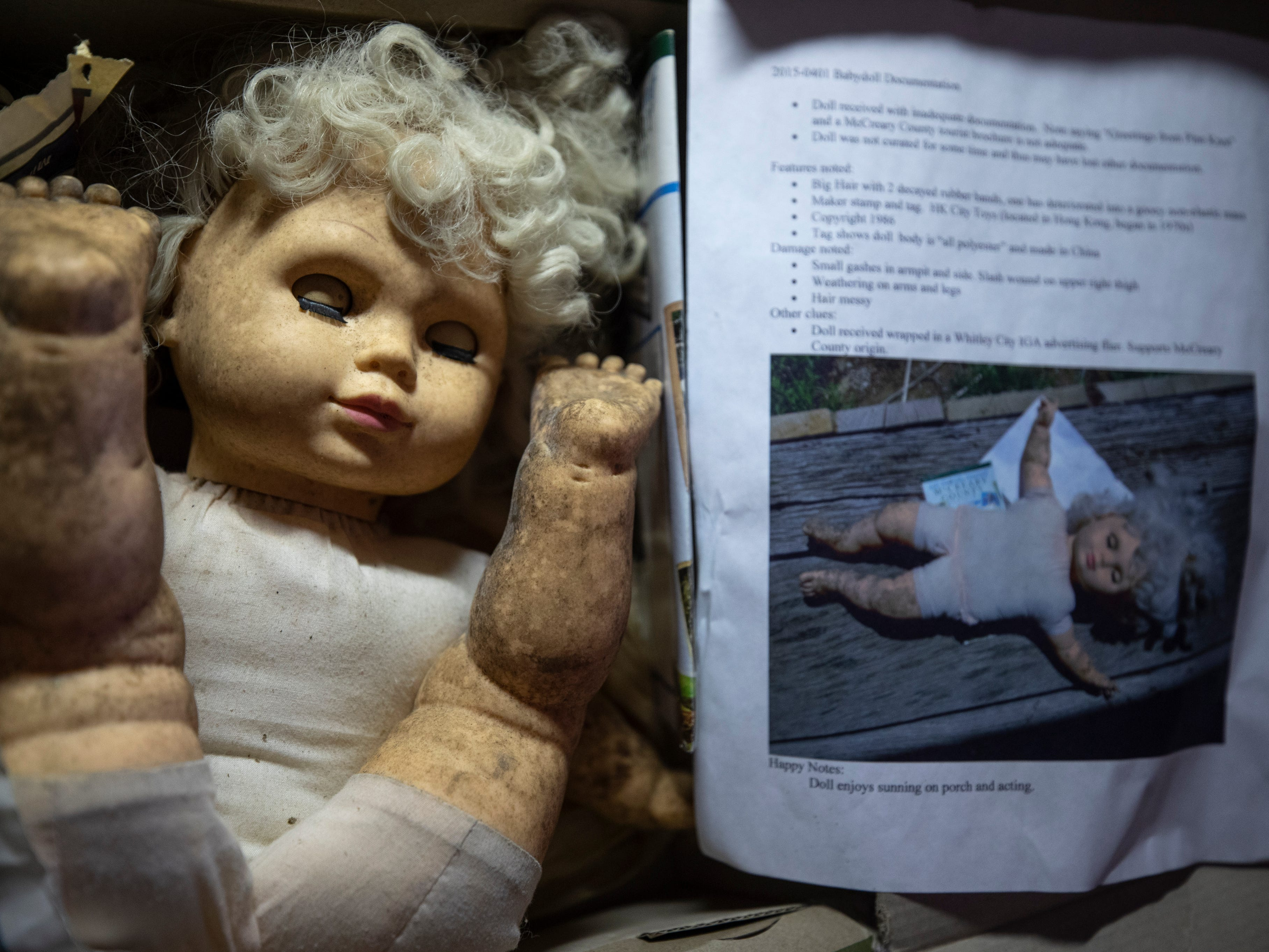 An abandoned doll resides in a box with specific documentation regarding its abandonment. April 19, 2019