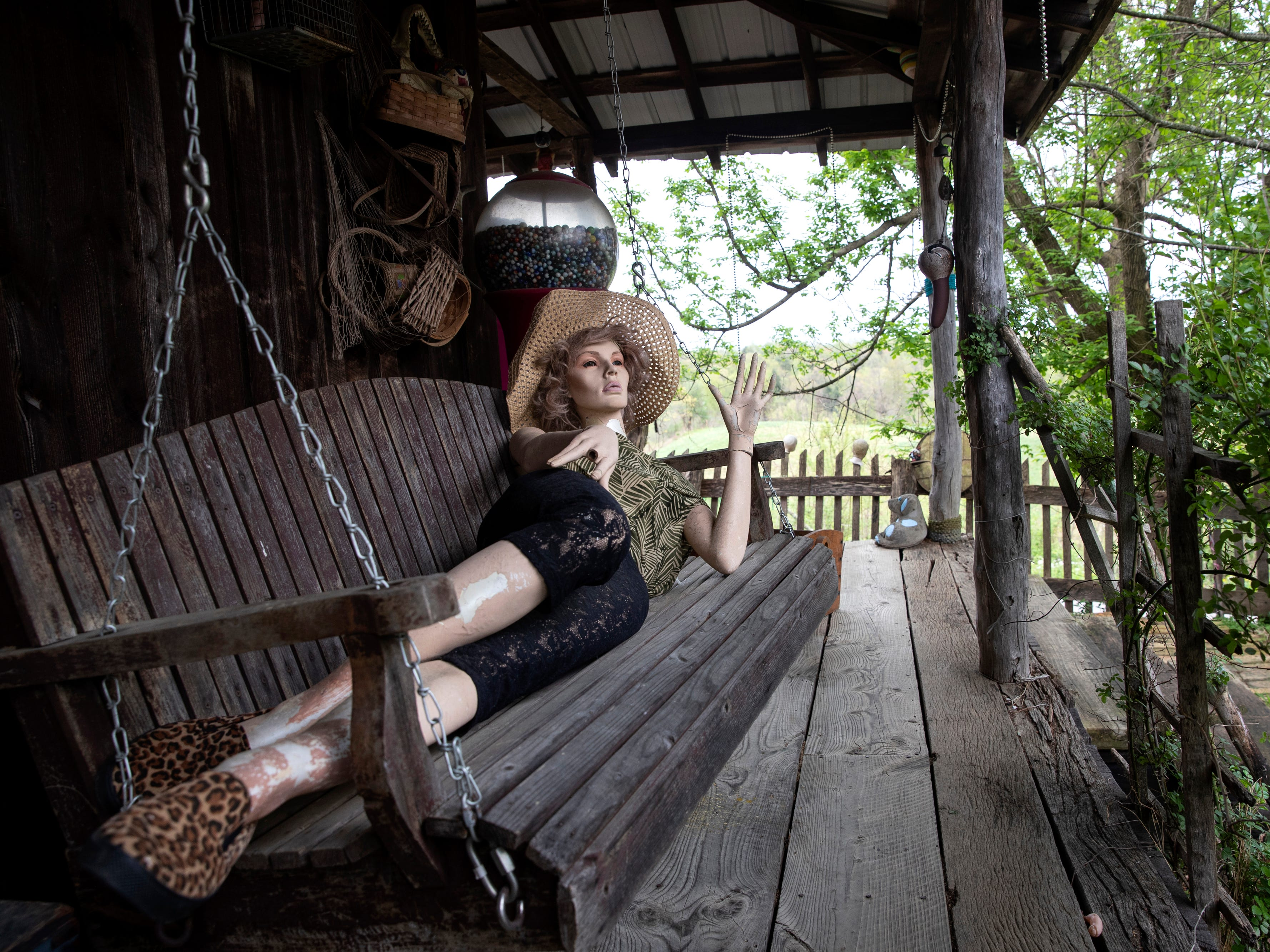 A mannequin reclines on a swing the Home for Wayward Babydolls. April 19, 2019