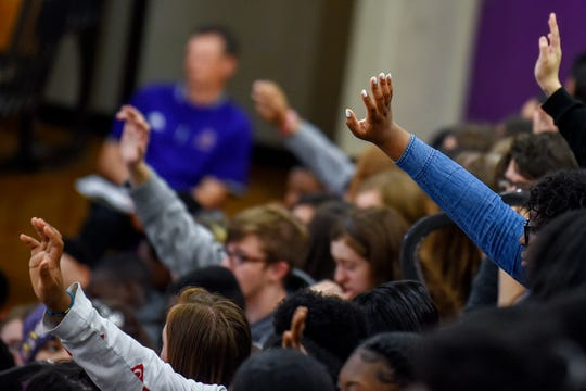 Students raise their hands when asked how many knew someone who has attempted suicide during the Stand4Change anti-bullying event on Friday, May 3, 2019, at Avondale High School in Auburn Hills. Bully prevention advocate Kevin Epling was one of the speakers during the event.