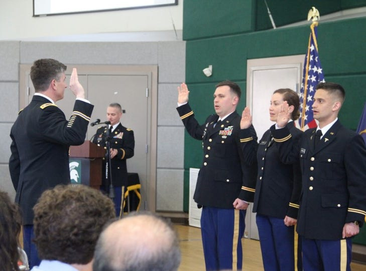 Lt. Col. Jason DeGeorge administers the oath of office to 2nd Lts. Ross Compher, Terra Crown and Alp Karaboga.  The oaths of office signify the lieutenants' acceptance of the commissions offered by the President of the United States.