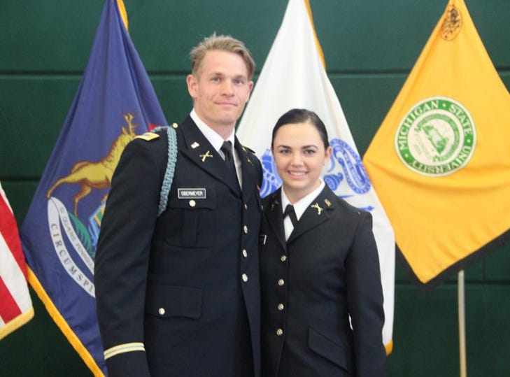 2nd Lt. Stockton Obermeyer and his wife 2nd Lt. Savannah Obermeyer after administration of the oath of office.  Many young officers ask their family or close friends administer the oath of office.  Any military officer holding a commission may administer the oath of office.  2nd Lt. Stockton Obermeyer is a 2018 MSU ROTC graduate.