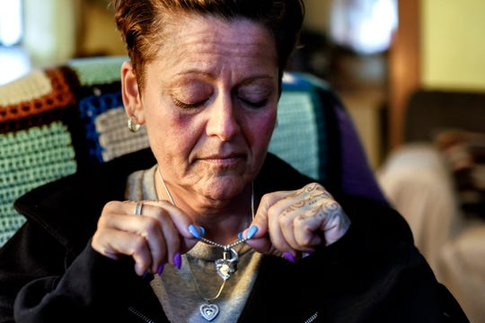 Joanna Wohlfert holds a memorial necklace containing a portion of her son's ashes at her home on Monday, April 29, 2019, in Lansing. Michael Martin, 13, died on Jan. 25, 2019, two days after attempting suicide in his home.