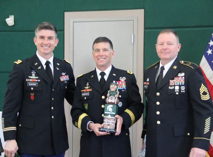 Lt. Col Jason DeGeorge and Master Sgt. Keith Barber present Maj. Gen. Daniel Ammerman a gift of appreciation for providing the key note address for the Spring 2019 MSU ROTC Commissioning Ceremony.