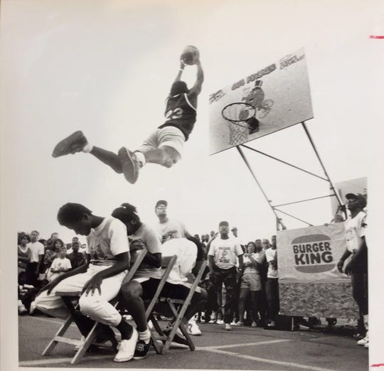 Dunk contests at the Gus Macker basketball tournament in downtown Lansing drew thousands of fans. They took place from 1989 to 1995.
