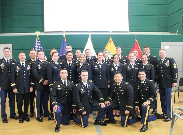 The Spring 2019 Commissioning Class from MSU ROTC program.  The class of twenty-one is the largest class in recent history. In the photo from left to right: (back row) Lt. Col. Jason DeGeorge, 2nd Lt. Ross Compher, 2nd Lt. Connor Plensdorf (obscured), 2nd Lt. Douglas Ryan, 2nd Lt. Drew Dunker, 2nd Lt. Joseph Delfrate, 2nd Lt. Jacob Meyer, 2nd Lt. Justin Roney, 2nd Lt. Dominique Meldrum, 2nd Lt. William Gischia, Master Sgt. Keith Barber, (middle row) Maj Gen. Daniel Ammerman, 2nd Lt. Jonathan Hoaglund, 2nd Lt. Terra Crown, 2nd Lt. Alp Karaboga, 2nd Lt. Morgan Baker, 2nd Lt. Shelby Cavazos, 2nd Lt. Naomi Dawood, 2nd Lt. Amanda Denney, 2nd Lt. Savannah Obermeyer, (kneeling) 2nd Lt. Sebastian Suntheimer, 2nd Lt. Kolton Kares, 2nd Lt. Joshua Kim, and 2nd Lt. Paul Schulman.