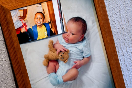 Two photos of Joanna Wohlfert's son, Michael Martin are displayed at her home on Monday, April 29, 2019, in Lansing. Michael, 13, died on Jan. 25, 2019, at Sparrow Hospital, two days after attempting suicide in his home.