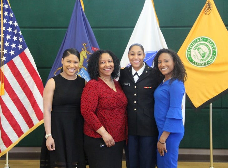 2nd Lt. Morgan Baker with her mother, Diane Venzant-Baker and her sisters, Jordan and Justine Baker.  Newly commissioned lieutenants ask family and friends to help affix their rank insignia (shoulder boards) to their uniforms.