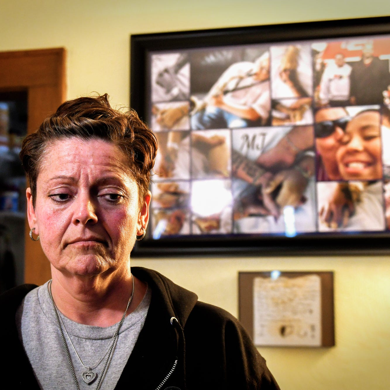 Joanna Wohlfert photographed at her home near a photo collage of her son Michael Martin and family members on Monday, April 29, 2019, in Lansing. Michael, 13, died on Jan. 25, 2019, at Sparrow Hospital, two days after attempting suicide in his home. Wohlfert says her son was bullied in the months leading up to his death.