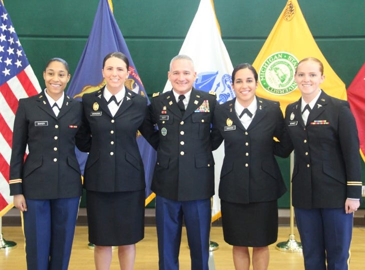 Newly commissioned lieutenants after they took the oath of office.  From left to right, 2nd Lt. Morgan Baker, 2nd Lt. Shelby Cavazos, Maj. Kevin Scott, 2nd Lt. Naomi Dawood, and 2nd Lt. Amanda Denney.