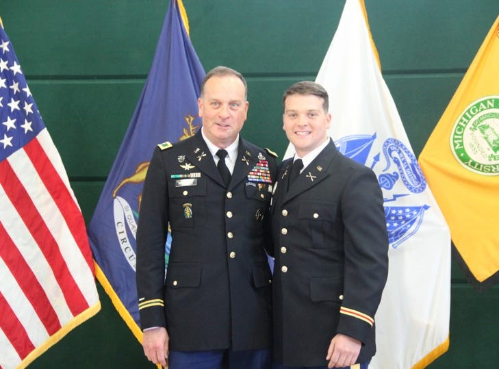 Retired Col. Robert Hoaglund and his son 2nd Lt. Jonathan Hoaglund after administration of the oath of office.  Many young officers ask their family or close friends to administer the oath of office.  Any military officer holding a commission may administer the oath of office.