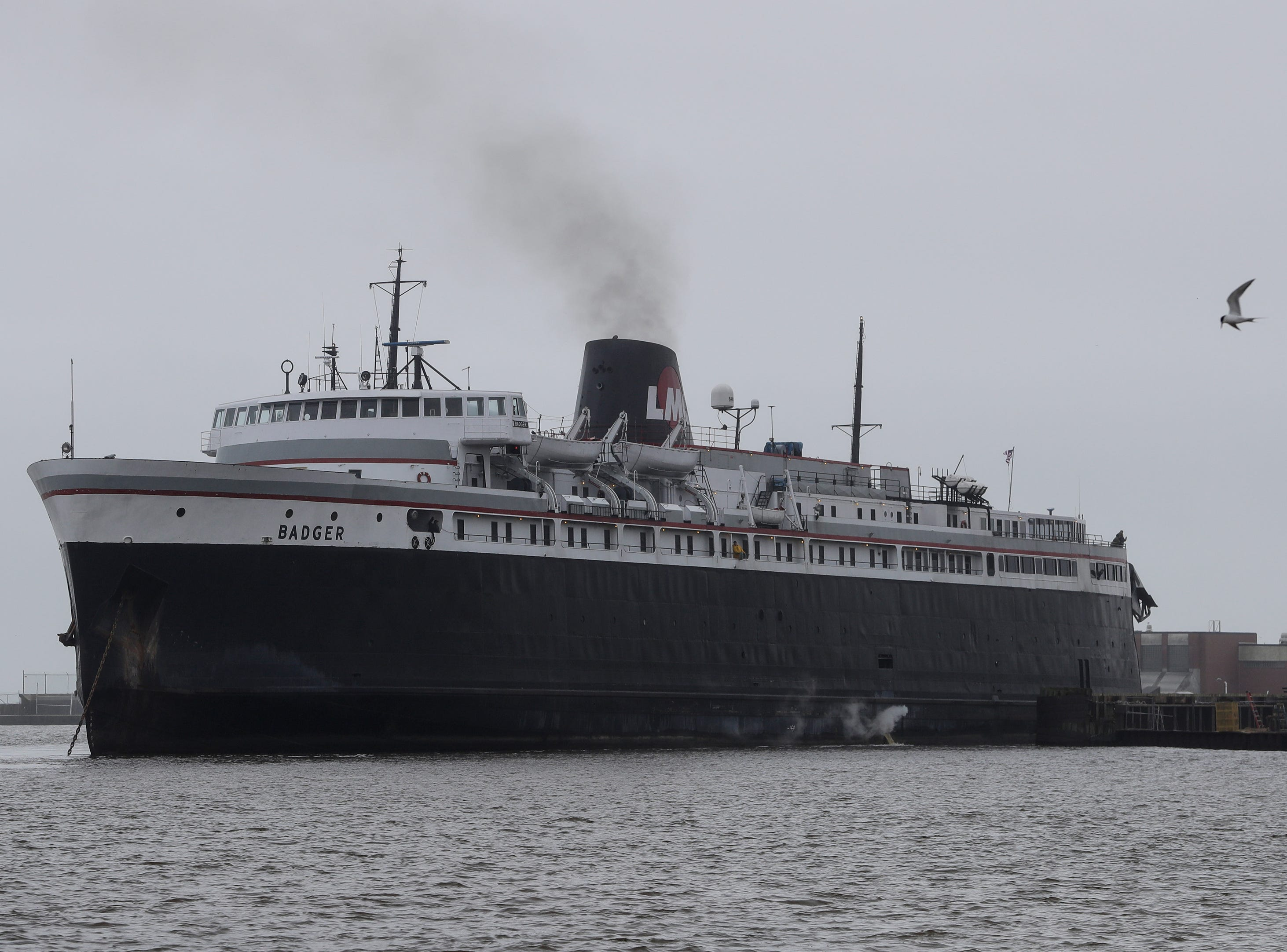 The S.S. Badger backs into the newly constructed dock and wall for the first time before its first sail Thursday, May 9, 2019, in Manitowoc, Wis. Joshua Clark/USA TODAY NETWORK-Wisconsin