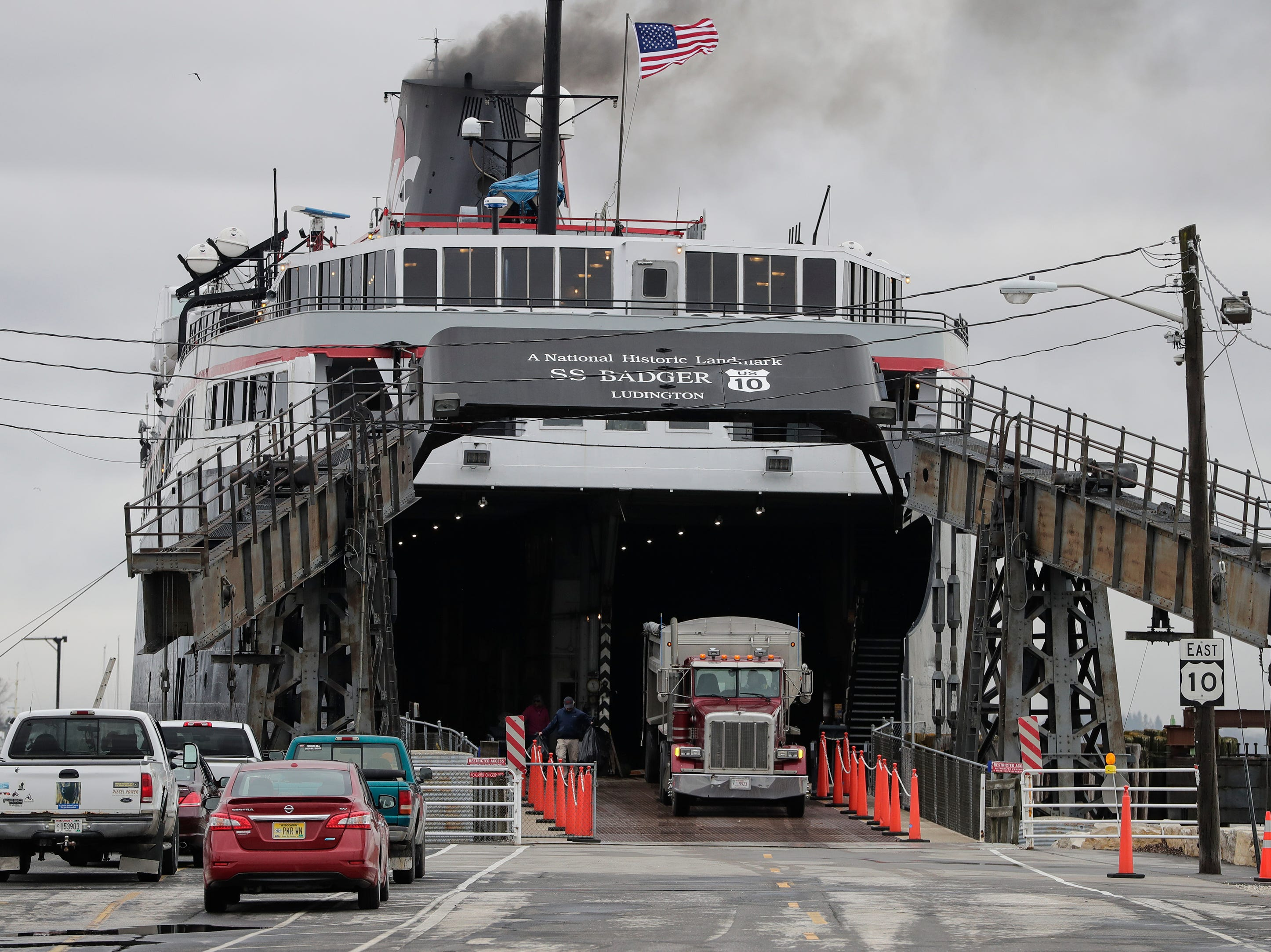 A semi backs into the S.S. Badger car ferry on the new car ramp Thursday, May 9, 2019, in Manitowoc, Wis. Joshua Clark/USA TODAY NETWORK-Wisconsin