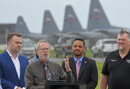 """Garland Gates speaks Thursday outside the 179th Airlift Wing about President Donald Tump's """"vanity project"""" of building a wall at the Mexican border and how its funding impacts local issues."""