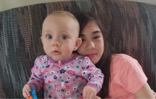 Katherine Boggs, 10 months, was killed in a two-vehicle crash on Ganges Five Points Road on Sunday. Her sister Faith, 12, at right, is on life support at Columbus Nationwide Hospital in critical condition, her father Josh Boggs said Thursday.