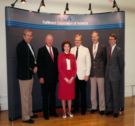 Larry Geissler, second from the right, stands with other officials with the former Fulfillment Company of America, which was based in Dayton.