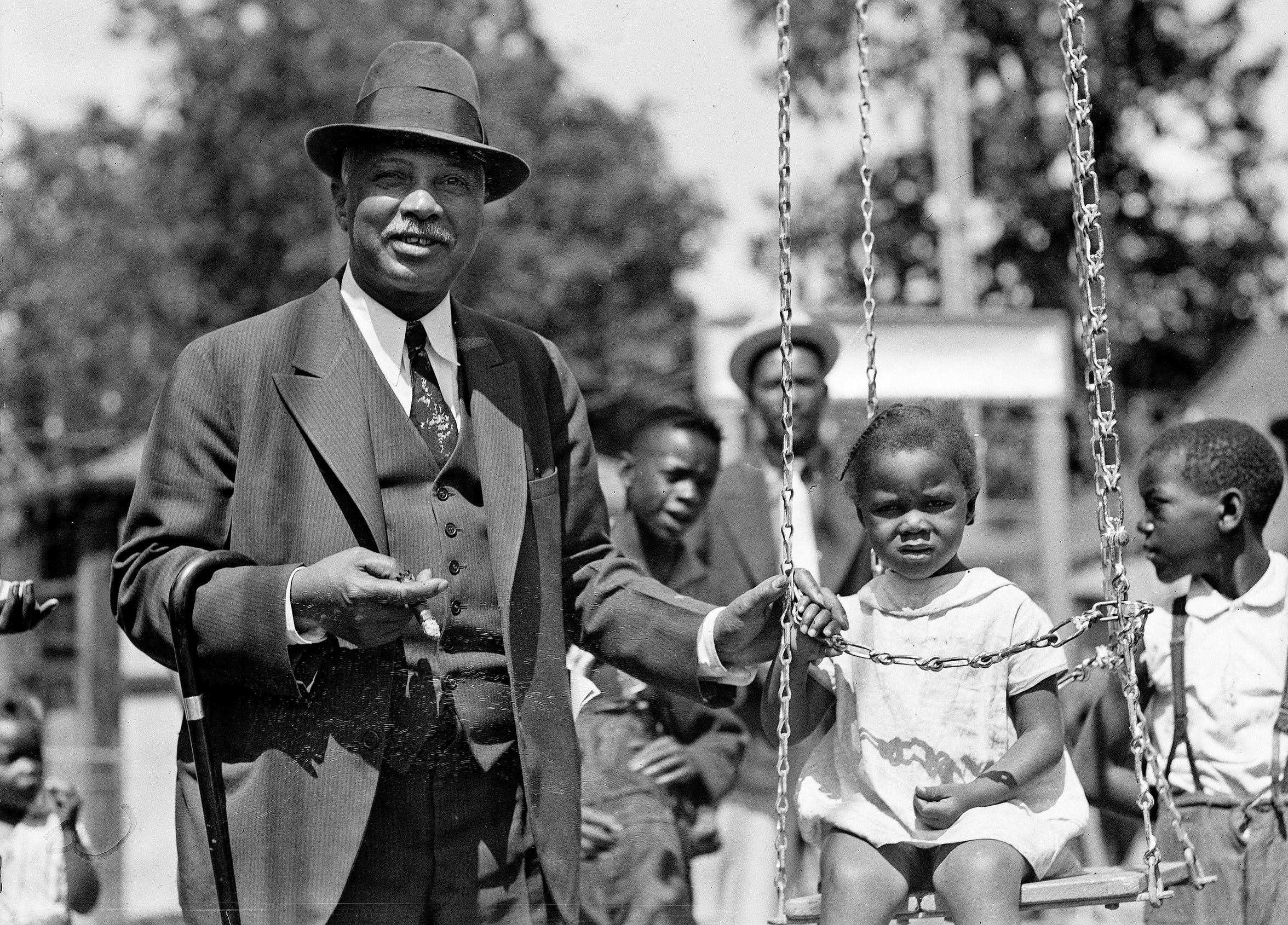 "W.C. Handy of New York was back on Beale Street in Memphis on May 14, 1936, where his blues began. The composer of ""St. Louis Blues"" and ""Memphis Blues"" visited the bar at ""Pee-Wee's"" and the street's Church Park to play with the children."