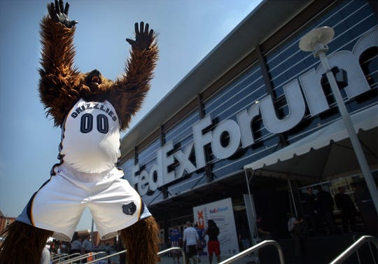 Grizz greets visitors during an open house celebration on Sept. 6, 2004, the day FedExForum's doors opened to the public.