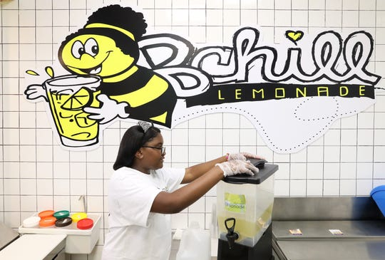 Kinyah Braddock, 10, CEO of B Chill Lemonade, prepares a dispenser of freshly squeezed lemonade at the Hickory Ridge Mall store Wednesday, May 8, 2019.