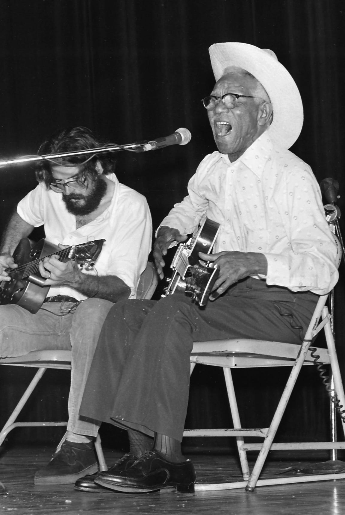 Memphis blues musician Furry Lewis belts out a song during a performance at the Orpheum Theatre accompanied by Lee Baker on Sept. 17, 1978.