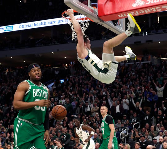 Milwaukee Bucks guard Pat Connaughton (24) dunks the ball in the 4th quarter during the Milwaukee Bucks 116-91 win over the Boston Celtics to win the Eastern Conference Semifinals Wednesday, May 8, 2019 in Milwaukee, Wisconsin.