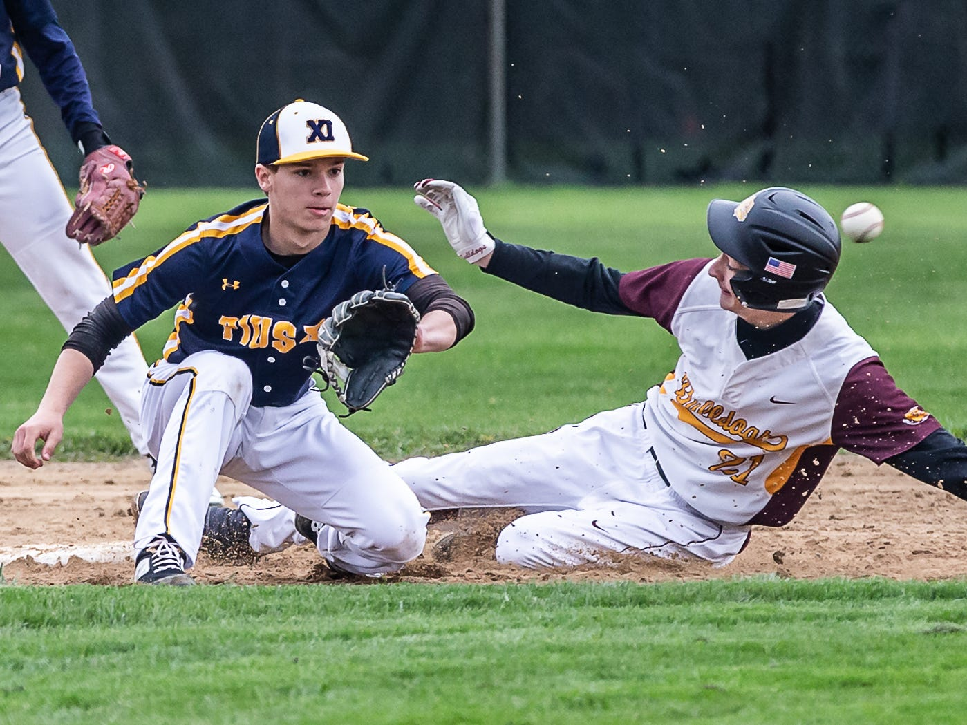 West Allis Central's Anthony LoCicero (21) steals second base as Pius XI's Logan Rademan (1) waits on the throw at West Allis on Wednesday, May, 8, 2019.
