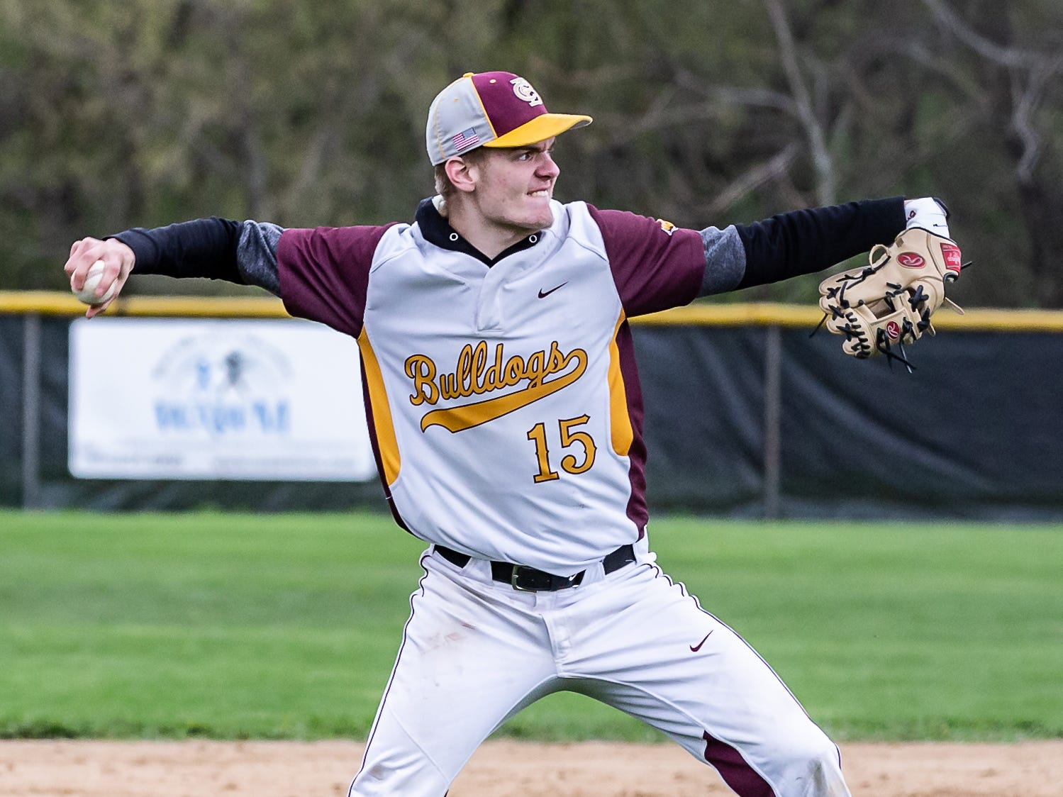 West Allis Central third baseman Cameron Drury (15) takes aim on first during the game at home against Pius XI on Wednesday, May, 8, 2019.