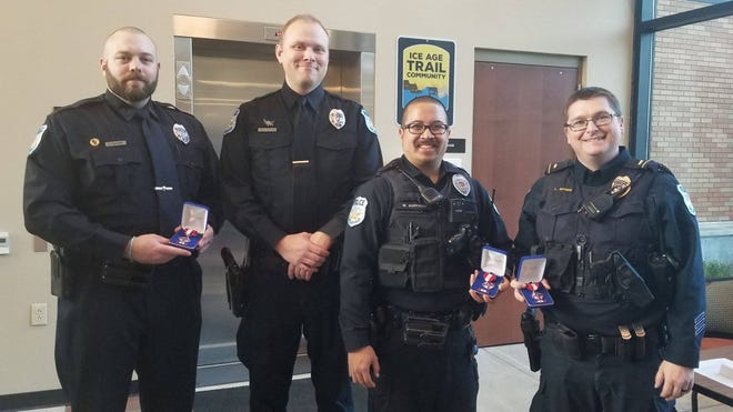 On May 6, members of the Delafield police department were honored for their life saving tactics in a December 2018 incident. Officers who were honored were (from left) Joe Walker, Steve Schrubbe, Will Hoffman and Lieutenant Landon Nyren.