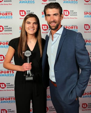 Arrowhead's Aubrey Hamilton poses with Michael Phelps after winning girls volleyball player of the year last year. She is nominated for the honor this year.