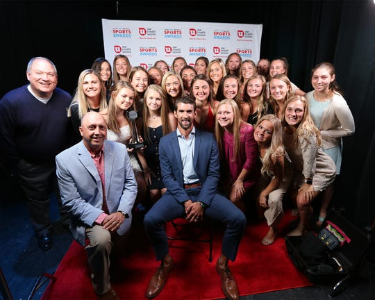 Former Olympic swimmer Michael Phelps poses with the Arrowhead girls lacrosse team, winner of the Top Team: Fan Vote Award at the 2019 Milwaukee Journal Sentinel High School Sports Awards show.