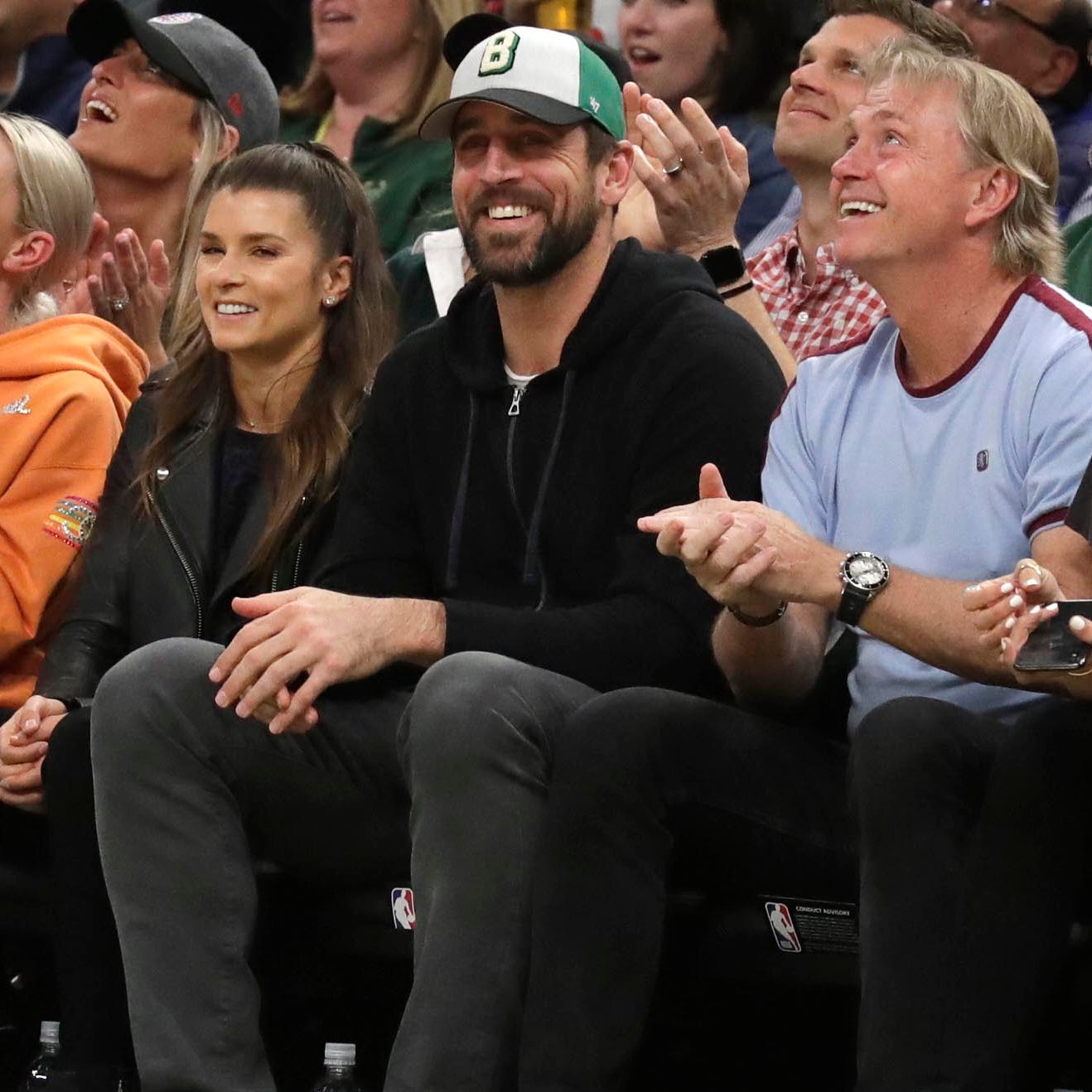 Twitter had a laugh when a fan presented Danica Patrick a drink with Aaron Rodgers sitting in the next seat