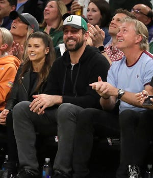 Green Bay Packers Aaron Rodgers and Danica Patrick watch the action during the Milwaukee Bucks vs. Boston Celtics NBA playoff game, Wednesday, May 8, 2019 in Milwaukee, Wisconsin.