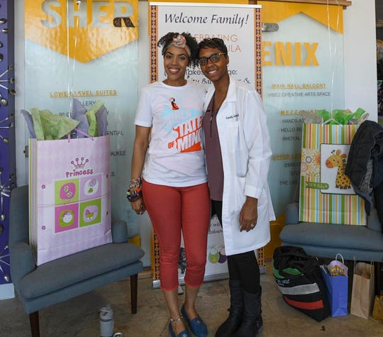 Doula Vanessa Johnson and Dr. Camille Garrison offer support to mothers during a community baby shower during World Doula Week in March 2019. Expectant moms received gift bags with baby items; stress-relieving massages and yoga classes; and information from doctors, midwives and doulas about pregnancy and childbirth.
